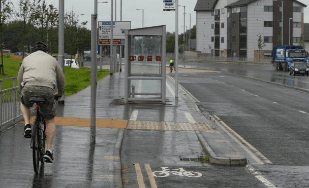 Bus shelter placed in middle of cycle lane, Glasgow