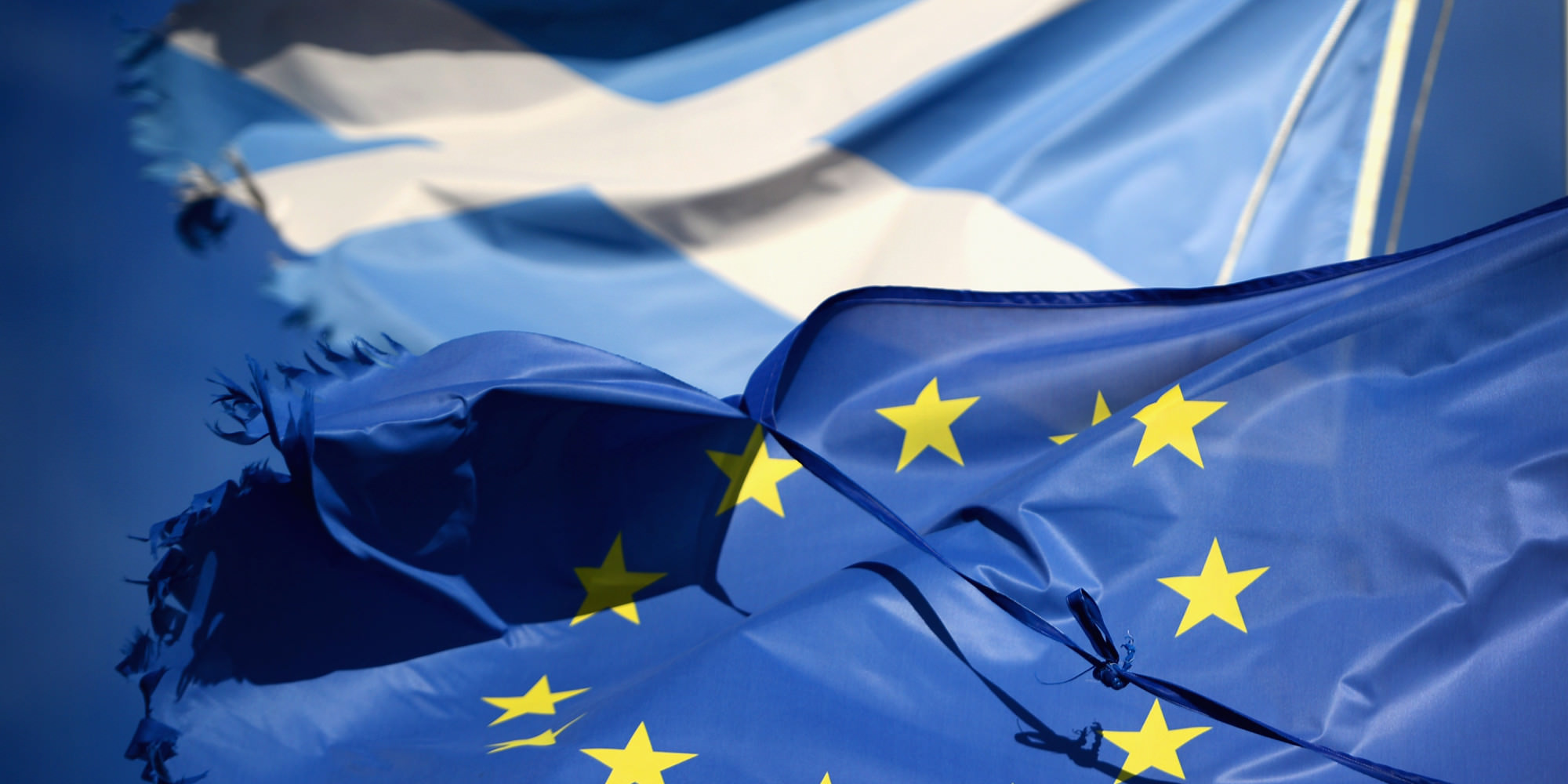 GLEN COE, SCOTLAND - MARCH 24: A European Union flag and Saltire flag blow in the wind near to Glen Coe on March 24, 2014 in Glen Coe, Scotland. A referendum on whether Scotland should be an independent country will take place on September 18, 2014. (Photo by Jeff J Mitchell/Getty Images)
